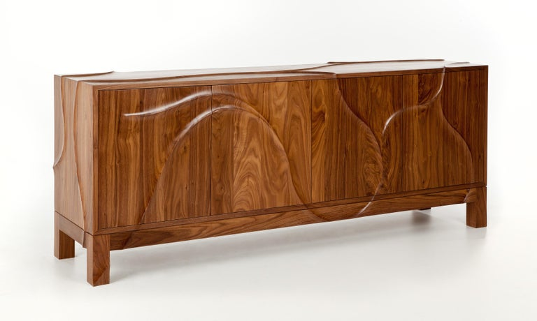 From our Esker collection, bespoke credenza in solid walnut. The surface is decoratively hand-carved with an organic, ridge pattern. Doors have a push-catch opening mechanism. Matte lacquer finish.