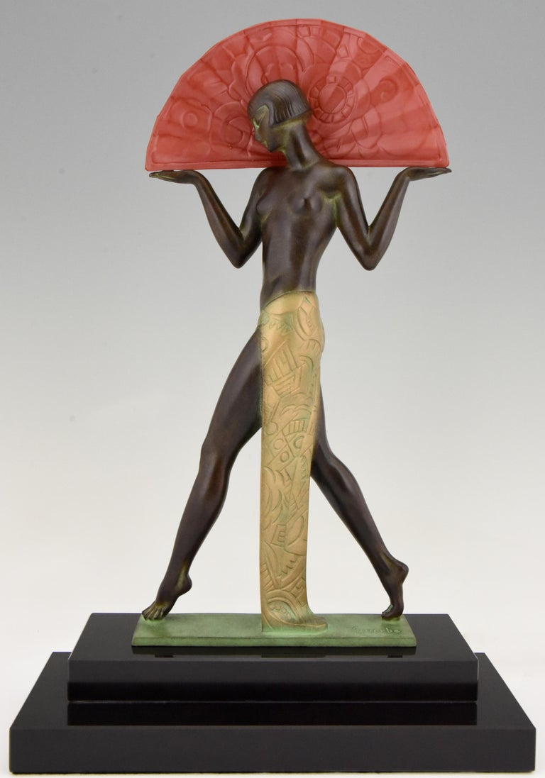 Espana an Art Deco style lamp Spanish dancer lady with fan. Signed by Raymonde Guerbe with foundry seal. Designed in 1920-1930. Posthumous contemporary cast at the Le Verrier foundry. Patinated art metal, red glass fan and black marble base.