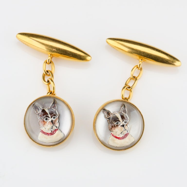 Carved crystal cabochons are painted on the reverse to portray two little black and white terriers. Perhaps the only thing more wonderful in the world than a pair of carved crystal cufflinks from England depicting man's best friend is a pair of