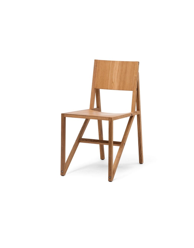 This tough lightweight chair is blessed with good proportions and seating comfort. A complex study in angles the straight lines of the wooden laths are adeptly balanced with the subtly curved seating and support surfaces. The frame chair is full of