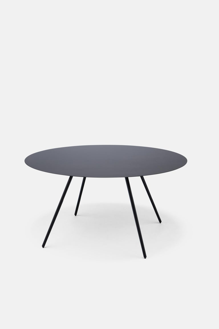 In 2008, international attention was caught when two Royal Designers for Industry, one from the world of furniture design and one from the world of Formula One racing car design, collaborated to create the Surface Table: a super slim composite