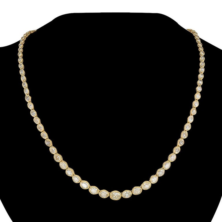 Estate 12.84 carats total weight oval and round diamonds and yellow gold Riviera necklace.  Love it because it caught your eye, and we are here to connect you with beautiful and affordable jewelry.  It is time to claim a special reward for Yourself!
