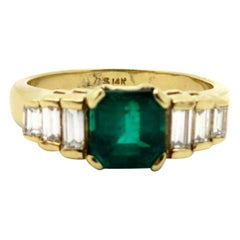 Estate 14 Karat Gold AGL Emerald Cut Columbian Emerald and Baguette Diamond Ring