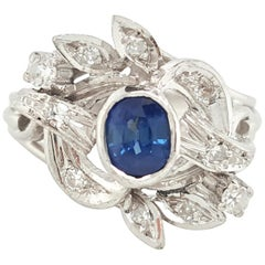 Estate 14 Karat White Gold Oval Blue Sapphire and Diamond Cocktail Ring