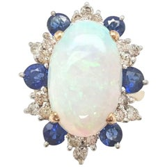 Estate 14 Karat Yellow and White Gold Opal Sapphire and Diamond Cocktail Ring