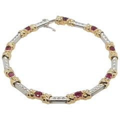 Estate 14 Karat Yellow and White Gold Oval Ruby Diamond Bracelet