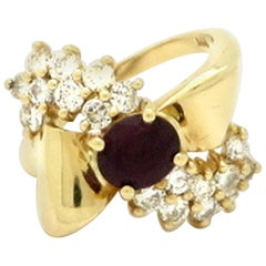 Estate 14 Karat Yellow Gold Ruby and Diamond Retro Style Bow Ring
