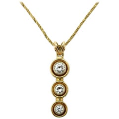 Estate 14 Karat Yellow Gold Three-Stone Diamond Bezel Necklace