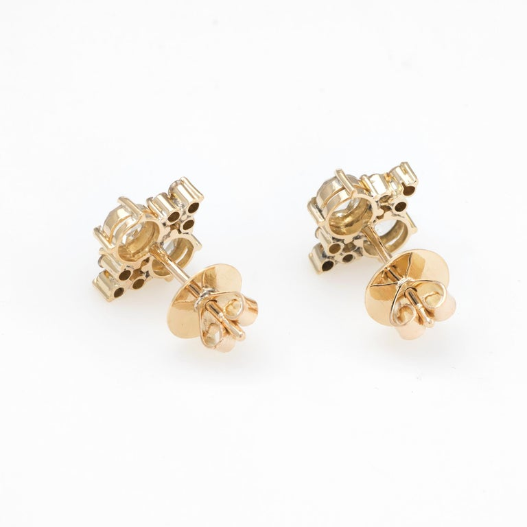 Elegant pair of estate diamond stud earrings, crafted in 14k yellow gold.   The four larger rose cut diamonds are each estimated at 0.30 carats, accented with 12 estimated 0.02 carat round brilliant cut diamonds. The rose cut diamonds are estimated