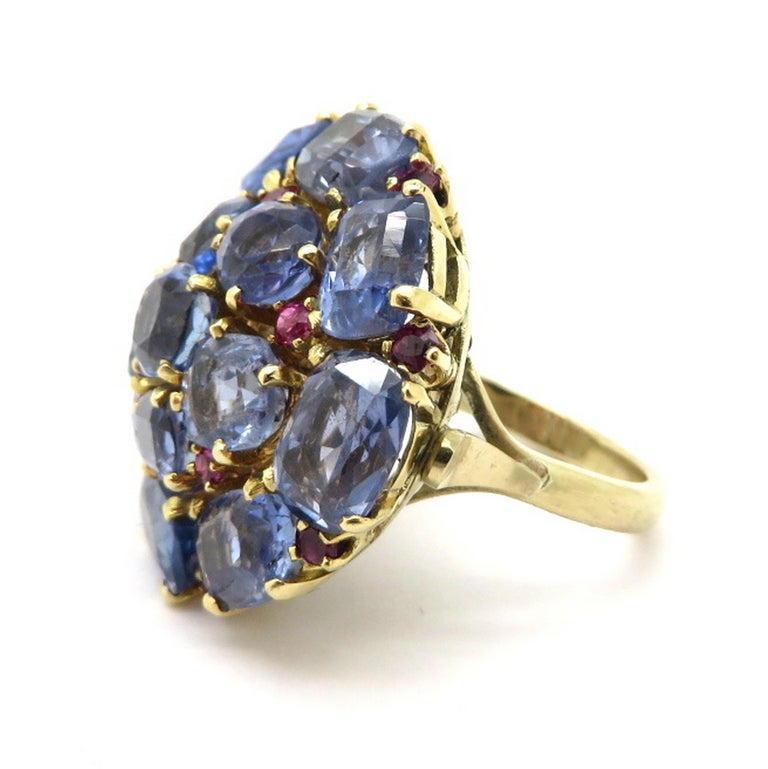Estate 14K yellow gold 20.00 carat GIA certified sapphire and ruby cluster fashion ring. Showcasing 14 fine quality GIA certified sapphires with no heat treatment, and 13 round brilliant cut fine quality ruby accents. The GIA colored stone report is