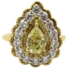 Estate 18 Karat Two-Tone Gold Pear Shaped White and Yellow Diamond Halo Ring