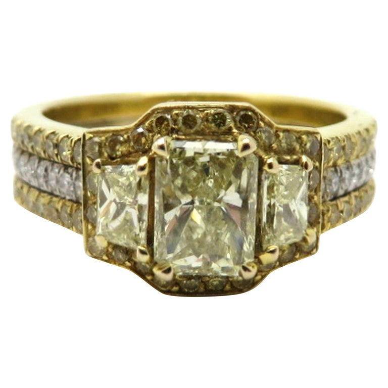 Estate 18 Karat Two-Tone Gold Radiant Cut Yellow Diamond and Trapezoid Ring For Sale