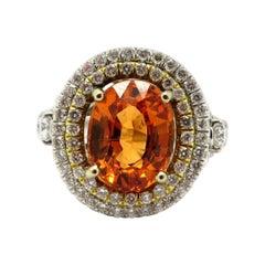 Estate 18 Karat Two-Tone Spessartite Garnet and Diamond Halo Ring