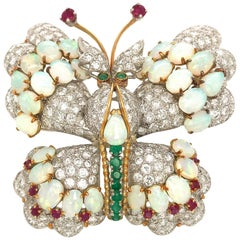 Estate 18 Karat White Gold Diamond, Ruby, Emerald and Opal Butterfly Brooch