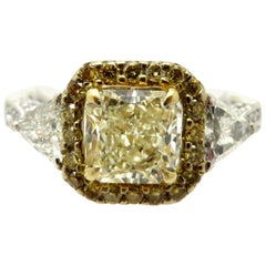 Estate 18 Karat White Gold Radiant and Trillion Yellow and White Diamond Ring