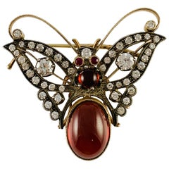 Estate 18 Karat Yellow Gold Diamond Garnet and Ruby Butterfly Brooch Pin