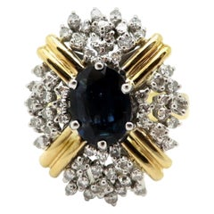 Estate 18 Karat Yellow Gold Oval Sapphire and Diamond Cocktail Ring