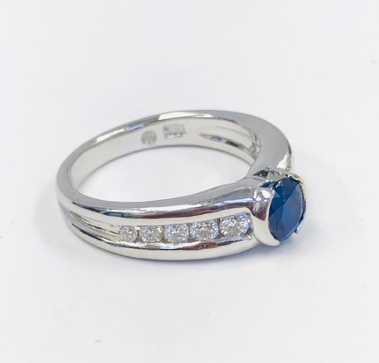 This Estate Ring, is in great condition, made in 18 Karat White Gold, set with 10 round Diamonds 0.42 carats and an Oval Burma Sapphire 0.79 carats. The rind size is 6-1/2, it can be adjusted to your size.