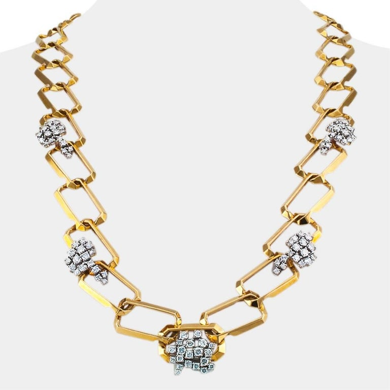1970's long diamond and gold link necklace. In every sense, this is a chic and cosmopolitan diamond and gold link necklace that makes a statement for the excellent taste of the woman wearing it. The jewel is fluid and supple as it contours to the