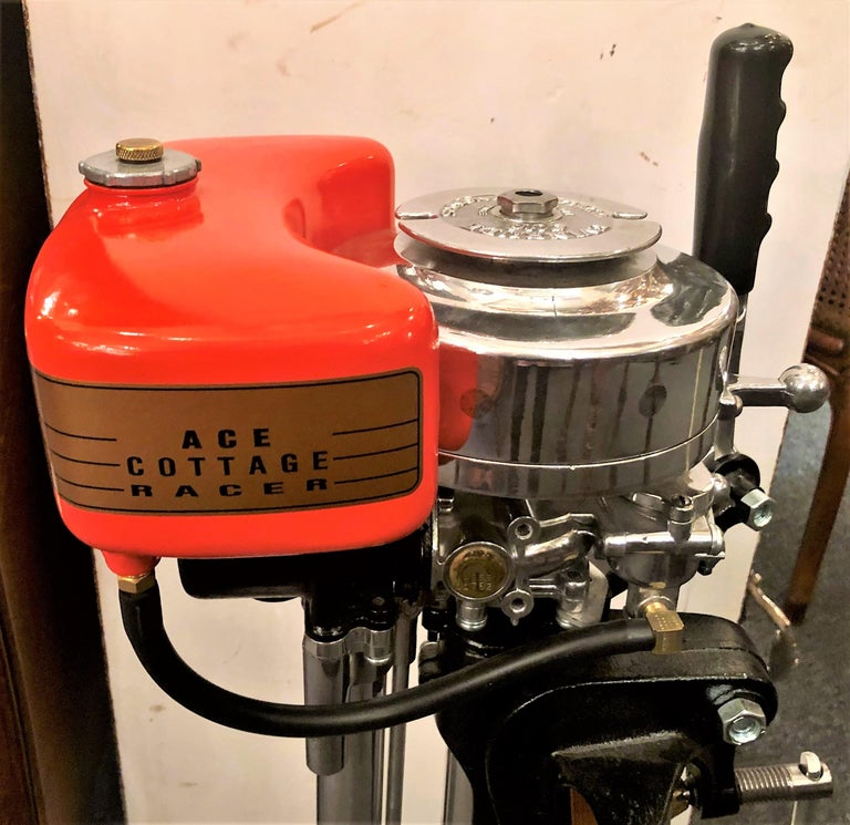Estate American Evinrude cottage racer outboard motor mounted on custom made stand, circa 1930s-1940s. Once a working motor, this piece has been restored as a collectible item and is not recommended for actual use.
