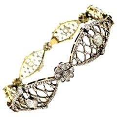 Estate Art Deco 18 Karat and Platinum Diamond Flower Tennis Bracelet