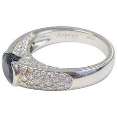 "Estate ""Asprey"" Platinum Diamond and 1.38 Carat Sapphire Ring"