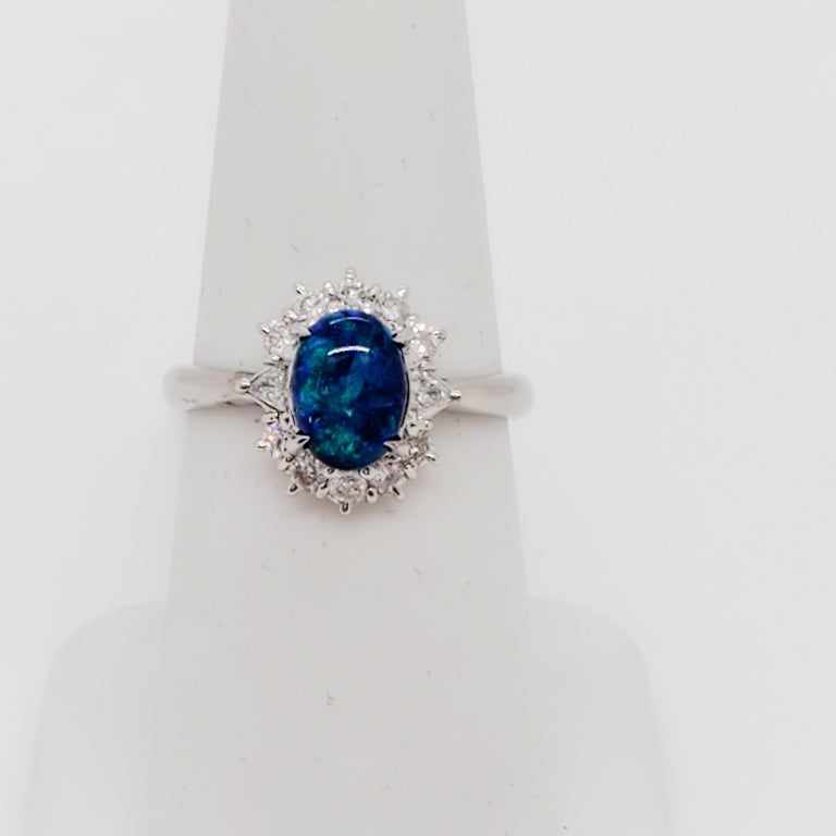 Estate Black Opal Oval and White Diamond Cluster Ring In Excellent Condition For Sale In Los Angeles, CA