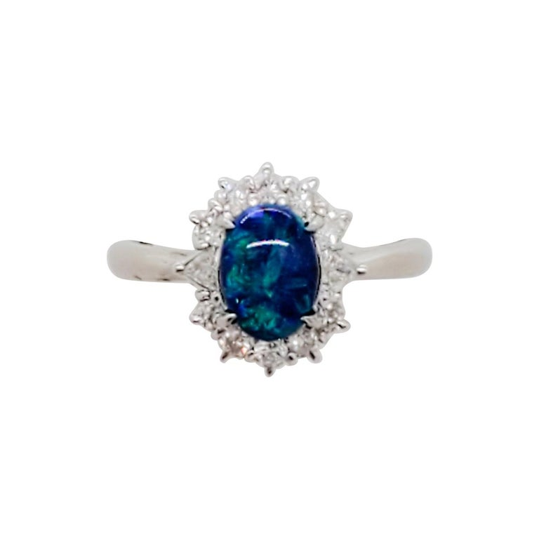 Estate Black Opal Oval and White Diamond Cluster Ring For Sale