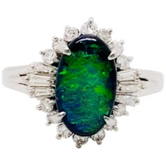 Estate Black Opal Oval and White Diamond Cocktail Ring in Platinum