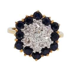 Estate Blue Sapphire and White Diamond Floral Cluster Ring in 18 Karat Gold