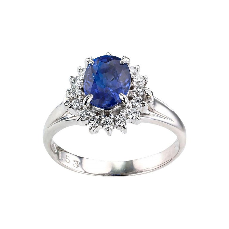 Contemporary Estate Blue Sapphire Diamond Platinum Ring For Sale