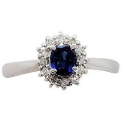 Estate Blue Sapphire Oval and Diamond Ring in Platinum