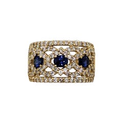 Estate Blue Sapphire Oval and White Diamond Band Ring in 18k Yellow Gold