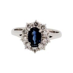 Estate Blue Sapphire Oval and White Diamond Cluster Ring in Platinum