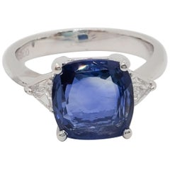 Estate Blue Sapphire Square Cushion and White Diamond Platinum Three-Stone Ring
