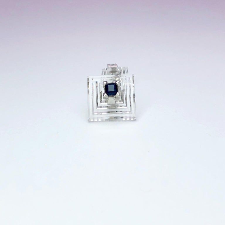 Carved crystal pyramid double ended cufflinks set with a square cut blue sapphire on either side .  Signed Cartier Platinum