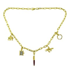 Estate Cartier Yellow Gold Santos Necklace with Set of Cartier Charms