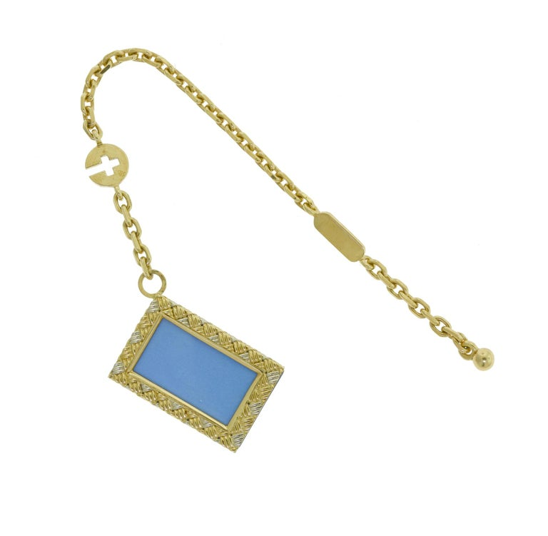 Brilliance Jewels, Miami Questions? Call Us Anytime! 786,482,8100  Style: Photo Key Holder    Metal:  White Gold, Yellow Gold   Chain Length: 5.5 in   Photo Case Holder : 1 in  Total Item Weight (g): 13.5  Dimensions: 25.4 x 18.40
