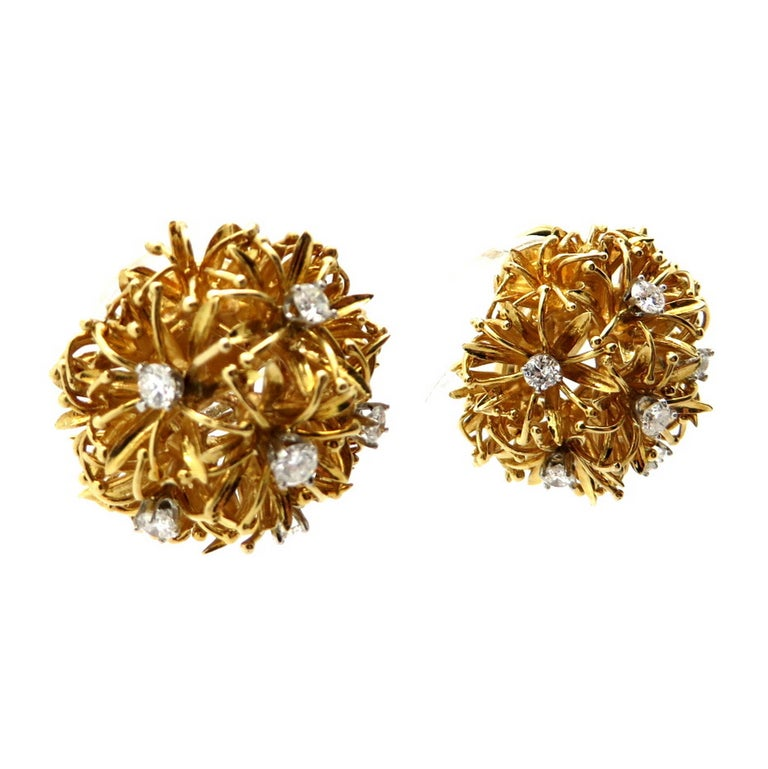 Estate designer David Webb 18K and platinum dandelion diamond earrings. Showcasing 12 round brilliant cut prong set diamonds weighing a combined total of approximately 1.30 carats. Diamond grading: color grade: F. Clarity grade: VS1. The earrings
