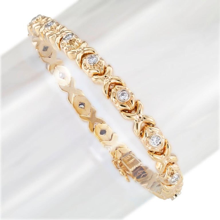 Estate diamond and yellow gold flexible bracelet circa 1990.  Love it because it caught your eye, and we are here to connect you with beautiful and affordable jewelry.  It is time to claim a special reward for Yourself!  Clear and concise
