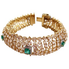 Estate Emerald and White Diamond Cluster Bracelet in 18 Karat Yellow Gold