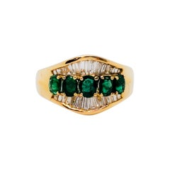 Estate Emerald Oval and White Diamond Cocktail Ring in 18 Karat Yellow Gold