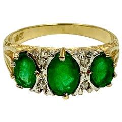 Estate Emerald Three-Stone Ring, 18 Karat Yellow Gold and Diamonds