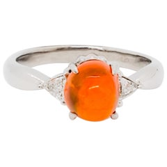 Estate Fire Opal Cabochon Oval and White Diamond Three-Stone Ring