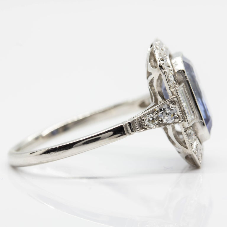 Composition: Platinum  •1 natural emerald cut sapphire 3.35ctw. •18 old mine cut diamonds H-VS2 0.50ctw. •2 baguette cut diamonds H-VS2 0.20ctw. Ring size: 7 ½  Ring face measure: 15mm x 13mm  Rise above finger: 5mm Total weight: 5.3 grams –