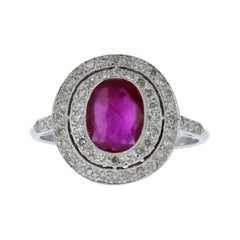 Estate Oval Ruby and Diamond Double Halo Ring