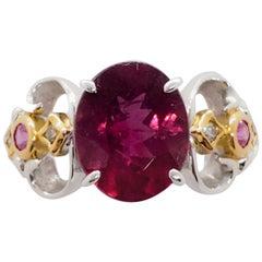 Estate Pink Tourmaline Oval, Pink Sapphire, and White Diamond Ring in 18 Karat