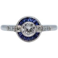 Art-Déco-Platinring mit Diamanten und Saphiren