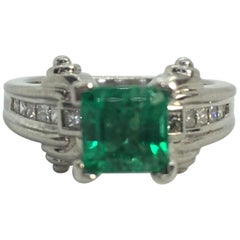 Estate Platinum Natural Colombian Emerald and Diamonds Solitaire Ring
