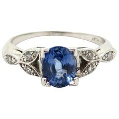Estate Platinum Oval Sapphire and Diamond Leaf Design Ring